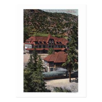 Le fer jaillit station et hôtel de route de dent carte postale