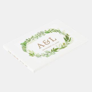 Le feuille de verdure tresse le livre d'invité