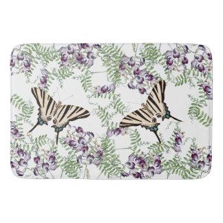 Le fleur sauvage de faune de papillons fleurit le tapis de bain