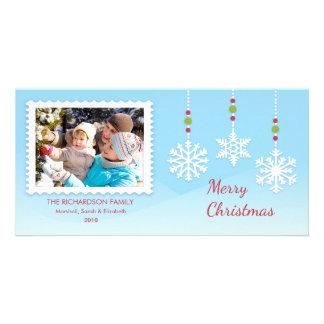 Le flocon de neige accrochant ornemente des cartes photocarte