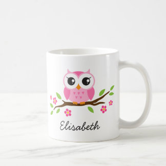 Le hibou sur la branche avec les fleurs roses a mug