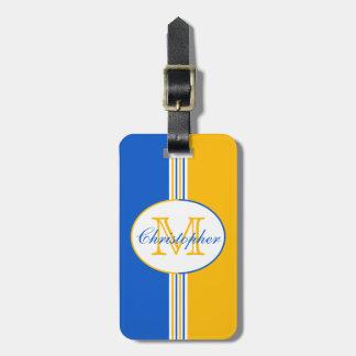 Le jaune bleu et d'or barre le monogramme étiquette pour bagages