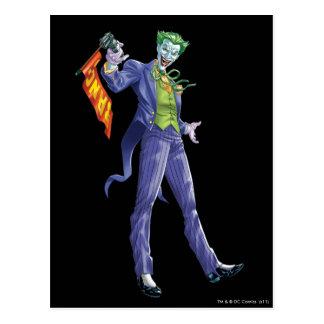 Le joker se tient avec l'arme à feu carte postale