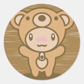Le jouet bourré de l'ours adhésif rond