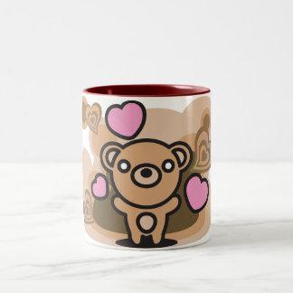 Le jouet bourré de l'ours tasse