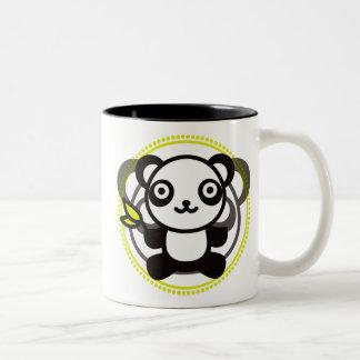 Le jouet bourré du panda tasses