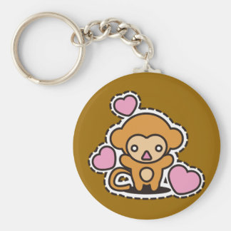 Le jouet bourré du singe porte-clé rond