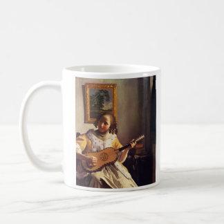 Le joueur de guitare par Johannes Vermeer Mug Blanc