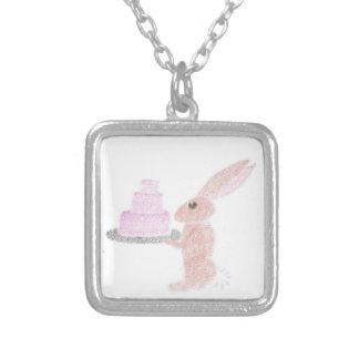 Le lapin met en évidence le gâteau pendentif carré