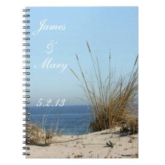 Le mariage de thème de plage prévoit le carnet