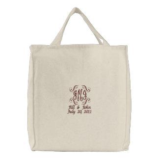 Le monogramme de mariage appelle le sac