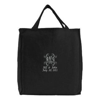 Le monogramme de mariage appelle le sac de noir de