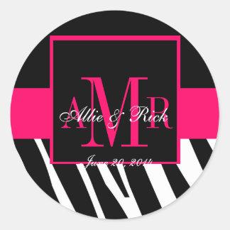 Le monogramme rose de zèbre appelle des étiquettes sticker rond