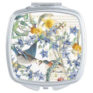 Le narcisse d'oiseaux d'oiseau bleu fleurit le miroirs de voyage