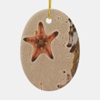 Le neutre artistique bronze des étoiles de mer sur ornement ovale en céramique