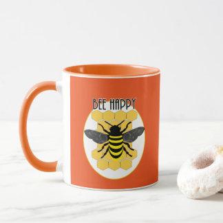 Le nid d'abeilles heureux d'amusement d'abeille tasse