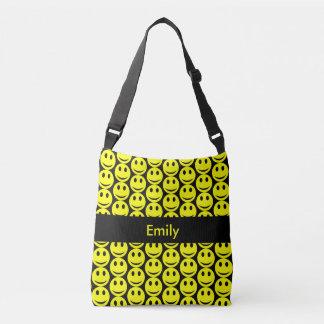 Le noir jaune souriant de sourire heureux de sac