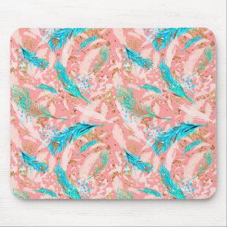 Le paon bleu rose fait varier le pas de la tapis de souris