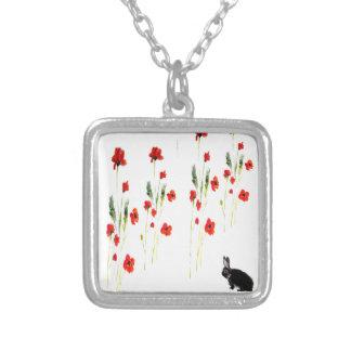 Le pavot fleurit le lapin pendentif carré