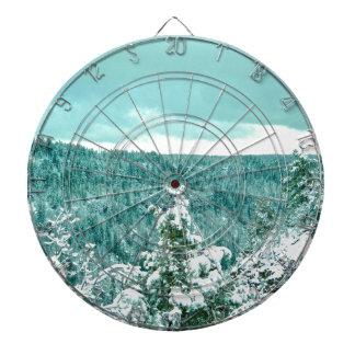 Le pays des merveilles d'hiver de forêt de montagn jeu de fléchettes