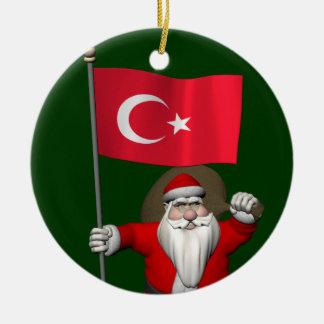 Le père noël adorable avec le drapeau de la décorations pour sapins de noël