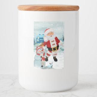 Le père noël drôle avec le bonhomme de neige étiquette pour bocaux