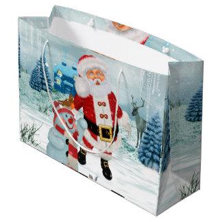 Le père noël drôle avec le bonhomme de neige grand sac cadeau
