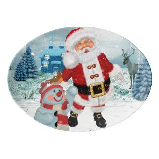 Le père noël drôle avec le bonhomme de neige plateau de service en porcelaine