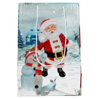 Le père noël drôle avec le bonhomme de neige sac cadeau moyen