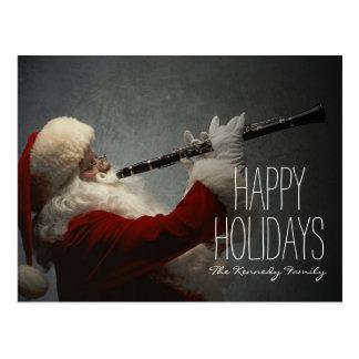 Le père noël jouant la clarinette cartes postales
