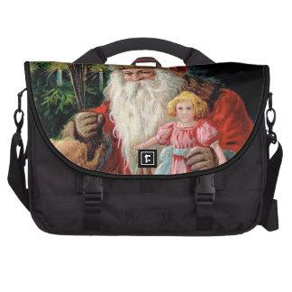 Le père noël rendant visite à une fille sacs ordinateur portable