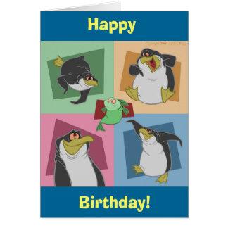 Le pingouin ajuste la carte d'anniversaire