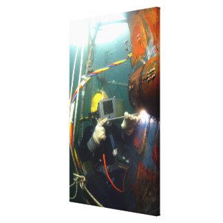 Le plongeur de marine des USA soude une correction Toiles