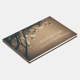 Le pot de maçon rustique de pays allume des arbres livre d'or
