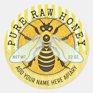 Le pot de miel marque le rucher d'abeille de nid sticker rond