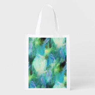Le résumé vert-bleu part du sac réutilisable