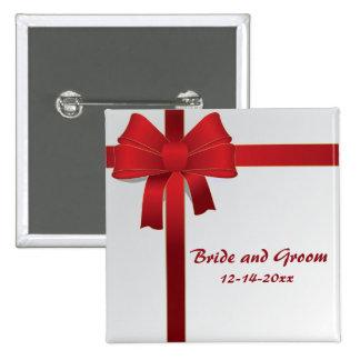 Le rouge cintre le mariage d'hiver badges