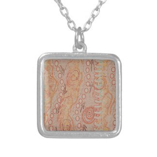Le sable fait écho l'art indigène de la collection pendentif carré