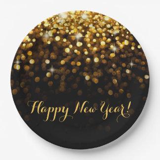 Le scintillement d'or de bonne année miroite de assiettes en papier