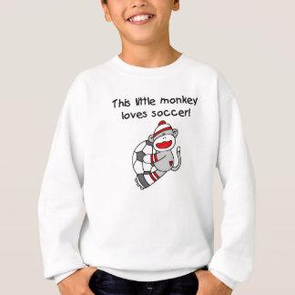 Le singe de chaussette aime des T-shirts et des