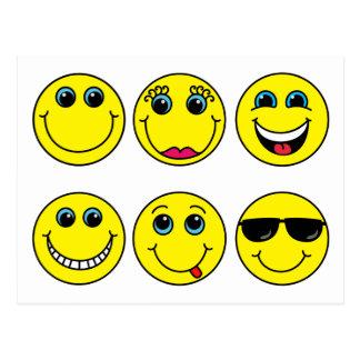 Le smiley fait face à des caractères cartes postales