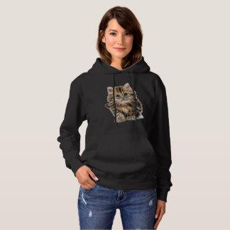 Le sweatshirt à capuchon des belles femmes dans la