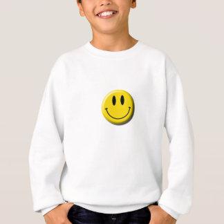 Le sweatshirt de l'enfant souriant de visage