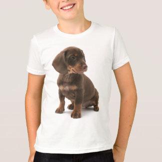 Le T-shirt de l'enfant de chiot de teckel