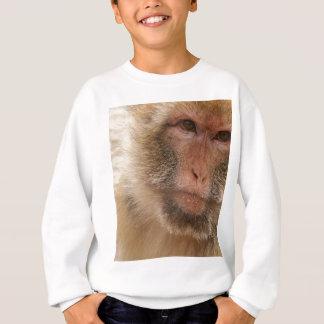 Le T-shirt de l'enfant de visage de singe