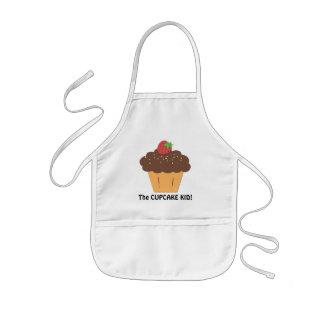 Le tablier de bonbon à enfant de petit gâteau