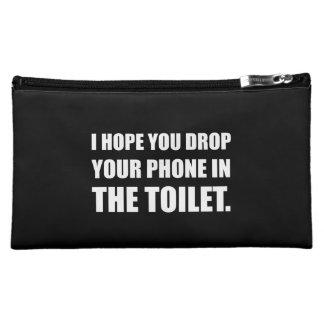 Le téléphone tombe dans la toilette pochette make-up