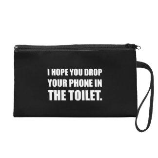 Le téléphone tombe dans la toilette sacs à main avec dragonne