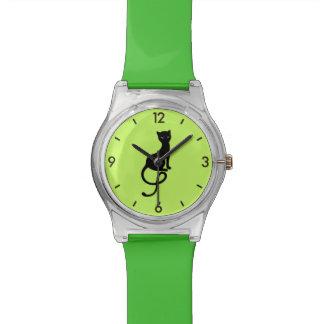 Le vert attache le chat noir mauvais aimable montres
