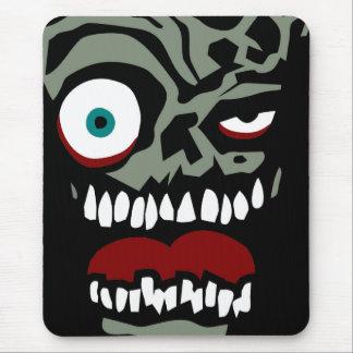 Le visage de zombi du sort malheureux tapis de souris